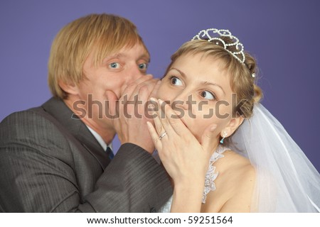 The groom tells to the bride confidential news - stock photo