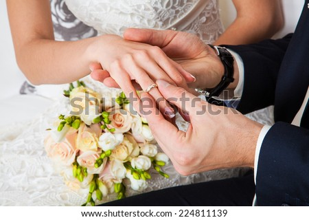 The groom wears the ring bride. Wedding ceremony. - stock photo