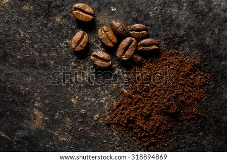 the ground coffee and coffee beans - stock photo