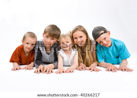 The group of five children lying on the floor
