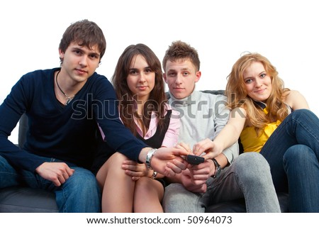 The group of friends watches TV sitting on a sofa - stock photo