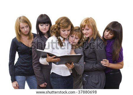 The group of girls looks the document