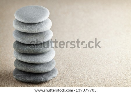 The group of stones lies on small sea sand