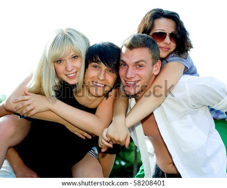 The group of young men and girls has fun - stock photo
