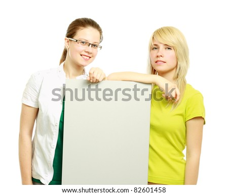 The group of young people holds the empty board for the text - stock photo