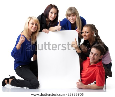The group of young people holds the empty board for the text on a white background. - stock photo
