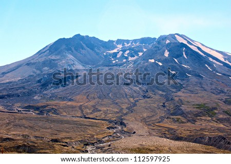 The growing lava dome inside Mt St Helens crater with steam releasing. - stock photo