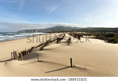 The Guincho Beach near Lisbon, Portugal, is famous for the excellent conditions for wind related sports such as windsurf and kitesurfing. - stock photo