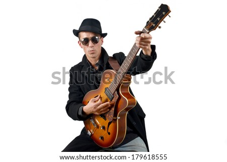 the guitarist and his instrument isolated on white background