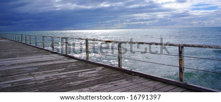 The Gulf St Vincent with an approaching rain front, from the Semaphore Jetty (Adelaide, Australia). - stock photo