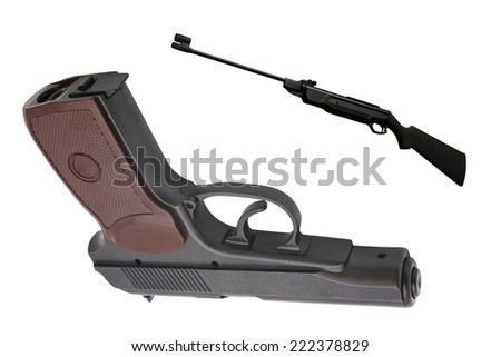 the gun under the light background - stock photo