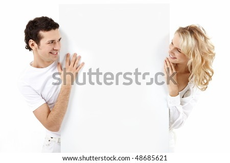 The guy and the girl exchange glances through an empty banner - stock photo