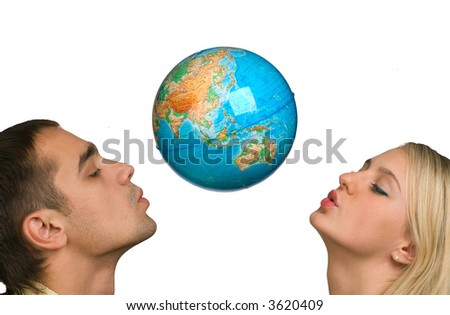 The guy and the girl hold the globe on a white background