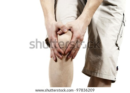 the guy behind the knee is kept isolated - stock photo
