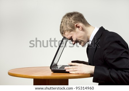 the guy frustrated with the laptop - stock photo