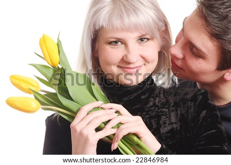 The guy gives to the beloved a bouquet of yellow colours