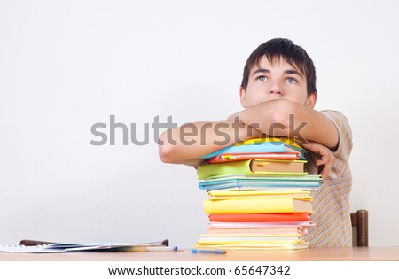 The guy has thought of a pile of books - stock photo