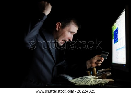 The guy in a jacket is angry with the monitor - stock photo