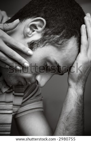 the guy is worried and feels sick and tired. - stock photo