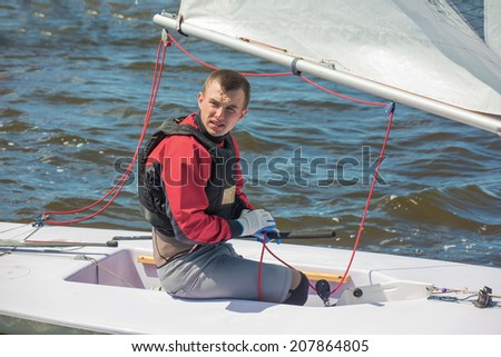 The guy on a yacht - stock photo