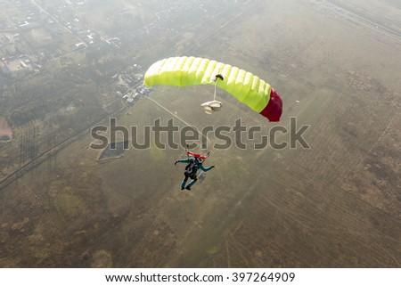 The guy  parachutist pilots his parachute. - stock photo