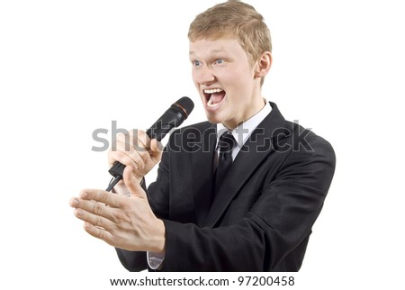 the guy shouts into the microphone isolated on a white background - stock photo