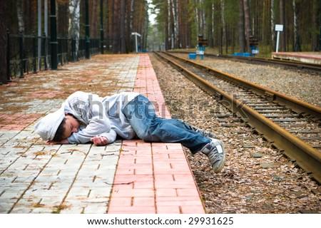 The guy sleeps expecting a train - stock photo