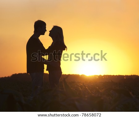 The guy with the girl against the sunset