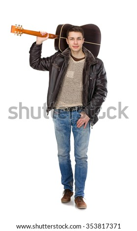 the guy with the guitar goes, holding a guitar over his shoulder, isolated on white background, in a leather jacket and jeans soft focus