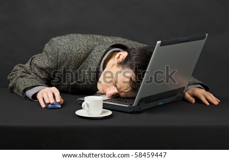 The guy worked at night in the Internet, was tired and has fallen asleep - stock photo