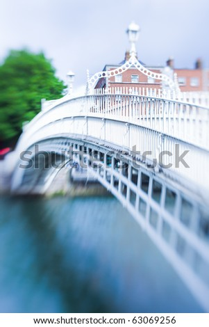 The ha'penny bridge in dublin, ireland with selective focus (tilt and shift lens) - stock photo