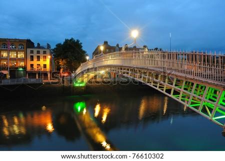 The Ha'penny Bridge over the  River Liffey in Dublin, Ireland. - stock photo