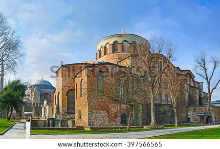 The Hagia Irene Orthodox Church with the minarets and dome of Hagia Sophia on the background, these landmarks are preserved Byzantine Temples in Istanbul, Turkey. - stock photo