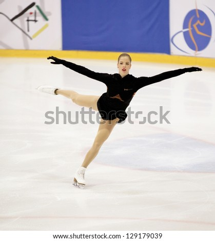 THE HAGUE - FEB 22: Carolina Kostner of Italy skates during warm-up at the Challenge Cup, figure skating competition, held on February 22, 2013 in The Hague, the Netherlands - stock photo