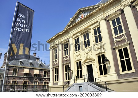 THE HAGUE, HOLLAND - JULY 31: Mauritshuis Museum in The Hague, Holland,  After the renovation in 2014. At the flag in Dutch the text :We are open again,July 31,2014 The Hague, Holland - stock photo