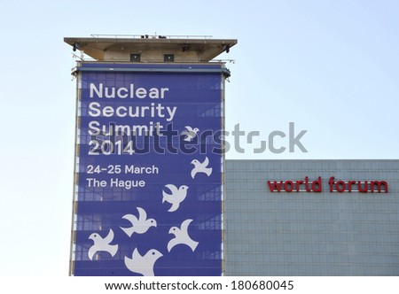 THE HAGUE, HOLLAND - MARCH 9, 2014: Large banner on a building, next to the world forum congress center, announcing the Nuclear Security Summit 2014 in The Hague, Holland on March 9, 2014 - stock photo