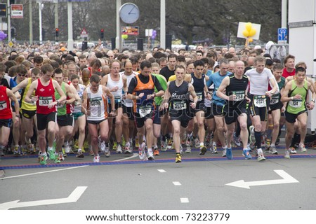 THE HAGUE, HOLLAND - MARCH 13: Runners at the start of the half marathon of The Hague, Holland on March 13, 2011