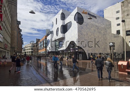 The Hague, Holland - May 5, 2015: People walk and cycle through the main shopping street Grote Marktstraat in central The Hague, Holland on May 5, 2015