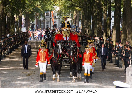 THE HAGUE, HOLLAND - SEPT 16: The carriage with Prince Constatijn van Oranje on the bicentennial Prinsjesdag (opening of parliamentary year by King) on September 16, 2014 in The Hague, Holland. - stock photo