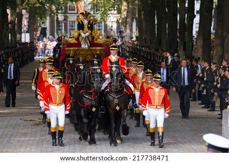 THE HAGUE, HOLLAND - SEPT 16: The golden carriage with Queen Maxima and King on the bicentennial Prinsjesdag (opening of parliamentary year by King) on September 16, 2014 in The Hague, Holland. - stock photo
