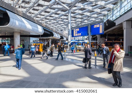 The Hague, Netherlands - April 21, 2016: main station with unidentified people. It is the with twelve tracks the largest terminal station in the Netherlands. The station was completed in 1973 - stock photo