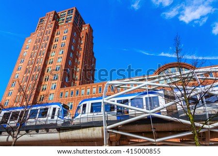 The Hague, Netherlands - April 21, 2016: Netkous viaduct at Beatrixkwartier with RandstadRail station and unidentified people. It is a modern construction designed by Zwarts & Jansma architects