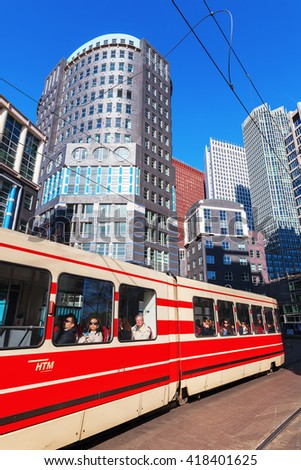 The Hague, Netherlands - April 20, 2016: old tram with unidentified people in The Hague. The Hague is seat of the Dutch government and the 3rd largest city of the Netherlands with 515,880 inhabitants