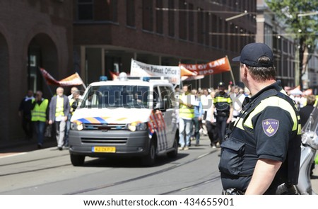 The Hague, Netherlands - June 9 2016: Demonstration of employees of the European Patent Office. The protest is against the dismissal  and degrade of colleagues for having criticized their employer