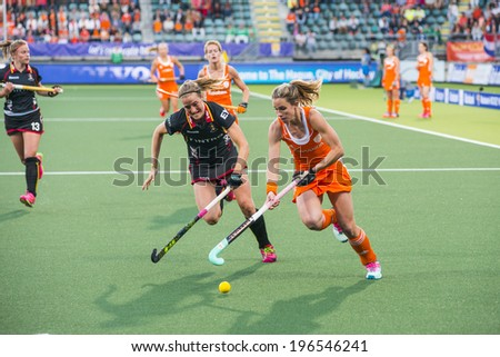 THE HAGUE, NETHERLANDS - JUNE 2: Dutch Hoog is lifting her stick to control the ball, Belgium player de Groof is trying to take over the ball during the Hockey World Cup 2014 NED beats BEL 4-0 - stock photo