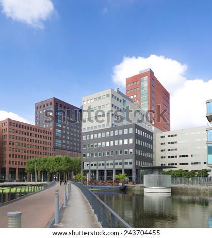 THE HAGUE, NETHERLANDS - SEPTEMBER 13, 2014: Modern office buildings in the netherlands. The Dutch government and parliament are located in the city, and it is also the residence of the royal family - stock photo