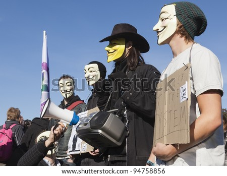 THE HAGUE – OCTOBER 15: Four masked members of Anonymous protesting during the Occupy protest on October 15, 2011 in The Hague, The Netherlands.