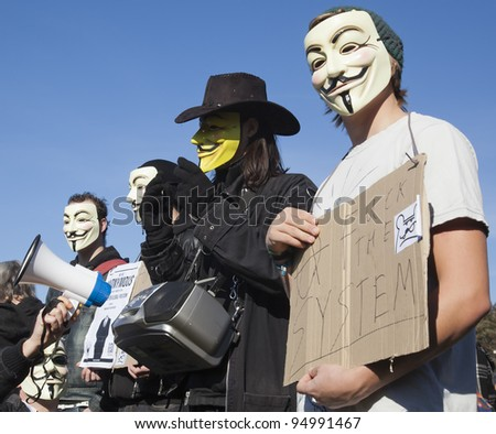 THE HAGUE – OCTOBER 15: Four masked members of Anonymous protesting during the Occupy protest on October 15, 2011 in The Hague, The Netherlands. - stock photo