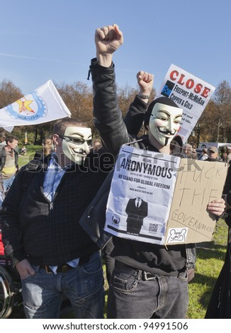 THE HAGUE – OCTOBER 15: Two masked members of Anonymous protesting during the Occupy protest on October 15, 2011 in The Hague, The Netherlands.