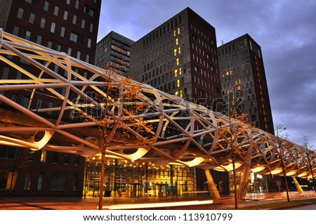 The Hague, The Netherlands, a modern tram viaduct calling: The 'Netkous' or Fishnet Stocking, in The Beatrixkwartier, a modern financial district in Den Haag, Holland - stock photo